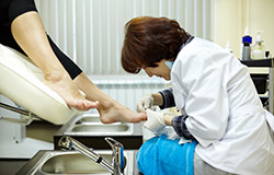 Female practitioner providing foot care